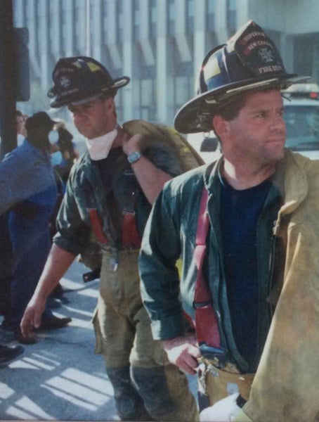 A NYFD firefighter and his partner at ground zero on 9/11/2001 just after the towers fell