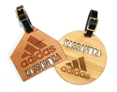 Laser cut and engraved bag tags with real leather strap.
