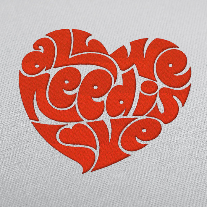 "The Beatles quote ""All we need is love"" embroidery design"