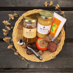 Black Friday 2019 honey jars, hand cream and spoon plus fall leaves and chestnuts in a basket