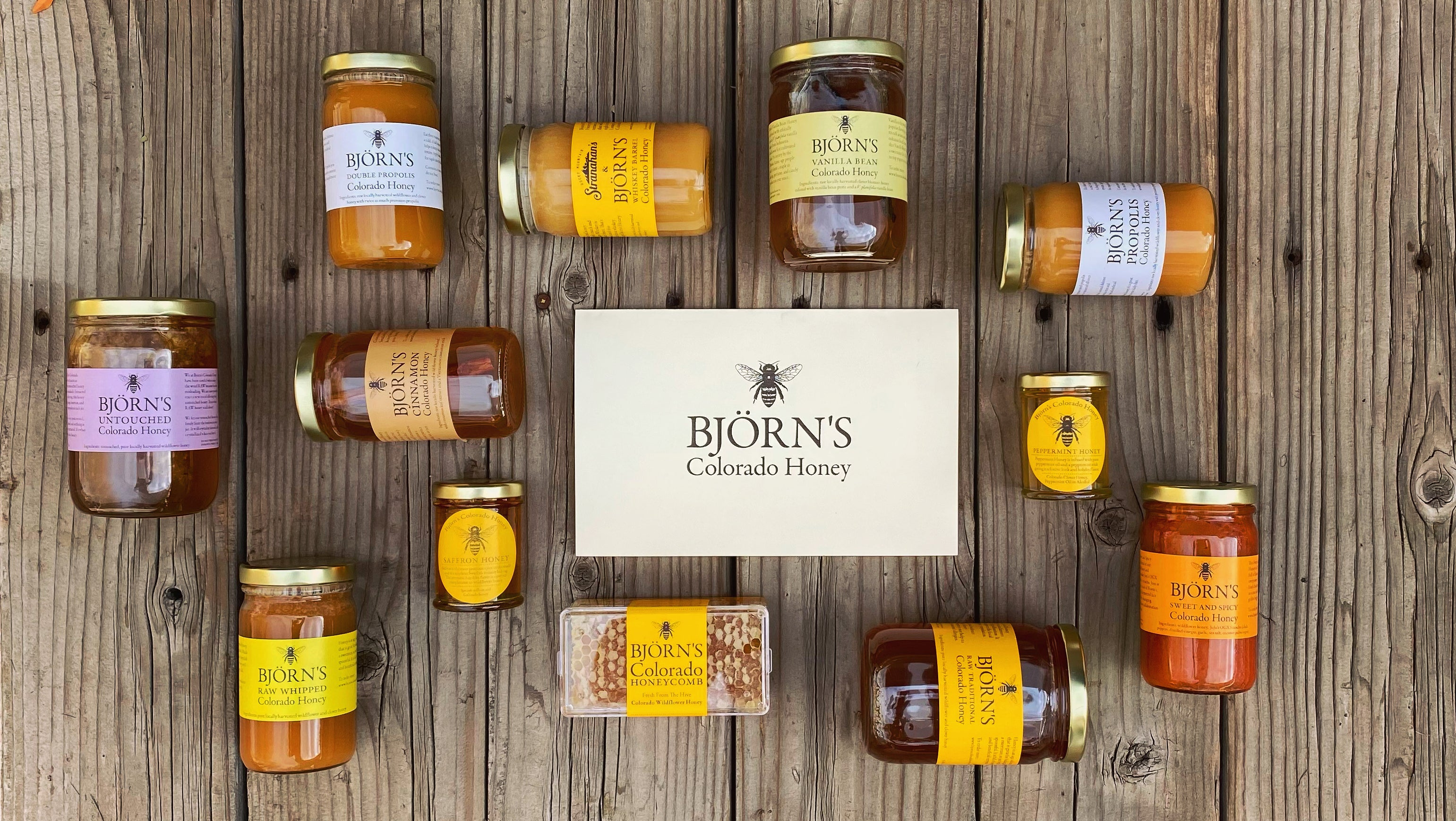 photo of multiple honey jars with a printed holiday card in the center