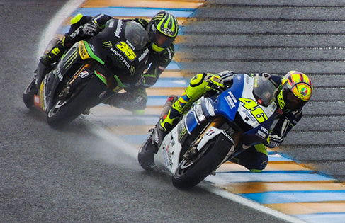 Rossi with Cal Crutchlow at the 2013 French Grand Prix, where he finished 12th