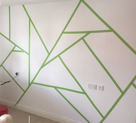 White wall covered with Frog Tape