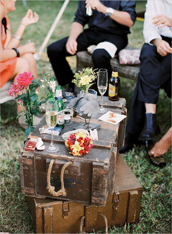 vintage suitcase used as a low table for drinks
