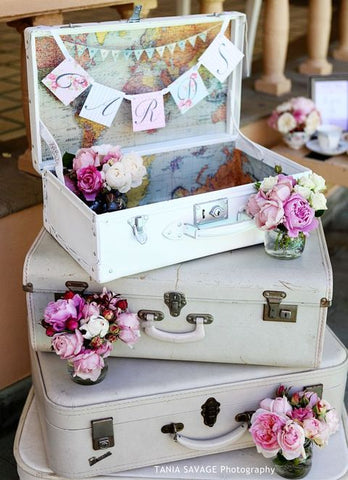 Vintage suitcase pile used as a wedding card box