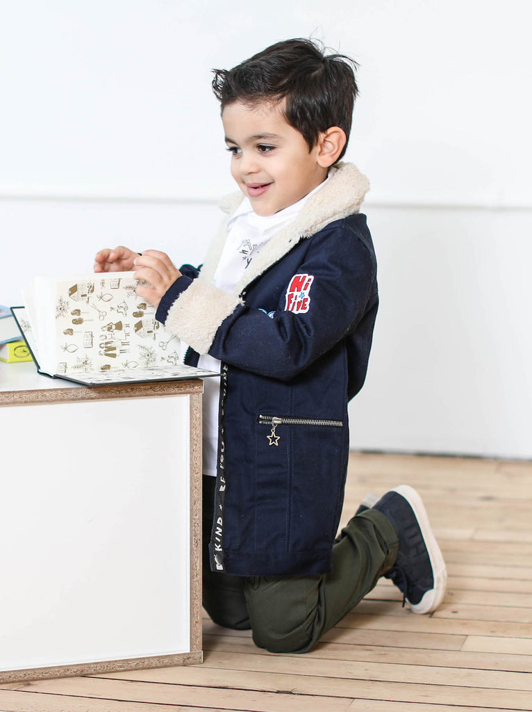 "Kinderkind 2T 3T 4T 5T 6 7 kids apparel Baby clothes Children's clothing  Kids Fashion Kids clothing  toddler clothes machine washable  Playwear  Boys clothing  Boys Sherpa Collar Jacket Long jacket with zip up detail Sherpa collar and cuff Front pockets with star zipper pockets ""Be You"" graphic grosgrain on placket Navy 97% cotton 3% spandex"