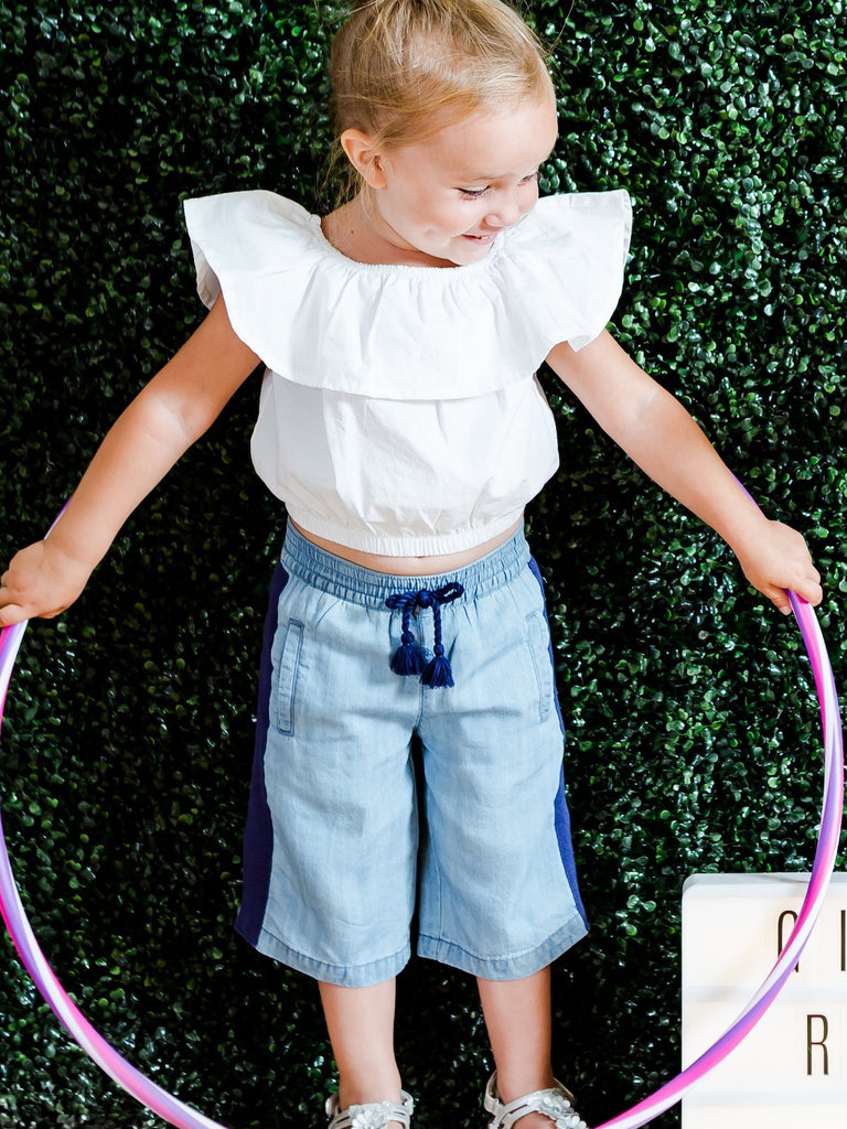 Kinderkind 2T 3T 4T 5T 6 7 kids apparel Baby clothes Children's clothing  Kids Fashion Kids clothing  toddler clothes machine washable  Playwear  Girls clothing  Girls Leggings Girls dresses  Girls High Waisted Pull-On Chambray Capri Pants Pull-on elastic waistband capri pants Side tripe and side welt pockets  Fringed faux drawstring  Back verbiage embroidery Machine washable 100% tencel chambray