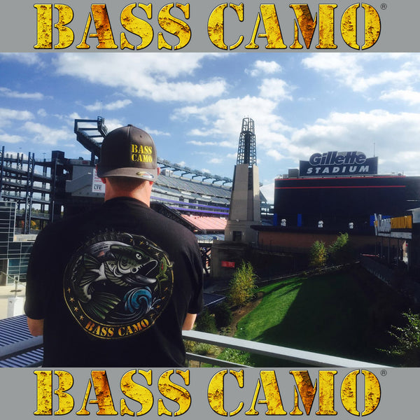 "Bass Camo ""Back In Black"" Fishing Shirt performance short sleeve t-shirt features front and back vibrant design 4.3 oz 100% ring spun cotton for superior softness with set-in baby rib collar and tear away label."