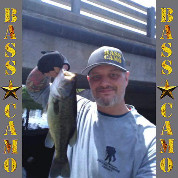 "Bass Camo FlexFit Tech Fishing Hat charcoal grey with pre-curved visor embroidered front and back in pro-stitch high thread count vibrant gold. FREE 4"" ROUND 3M PREMIUM DECAL INCLUDED WITH PURCHASE !"