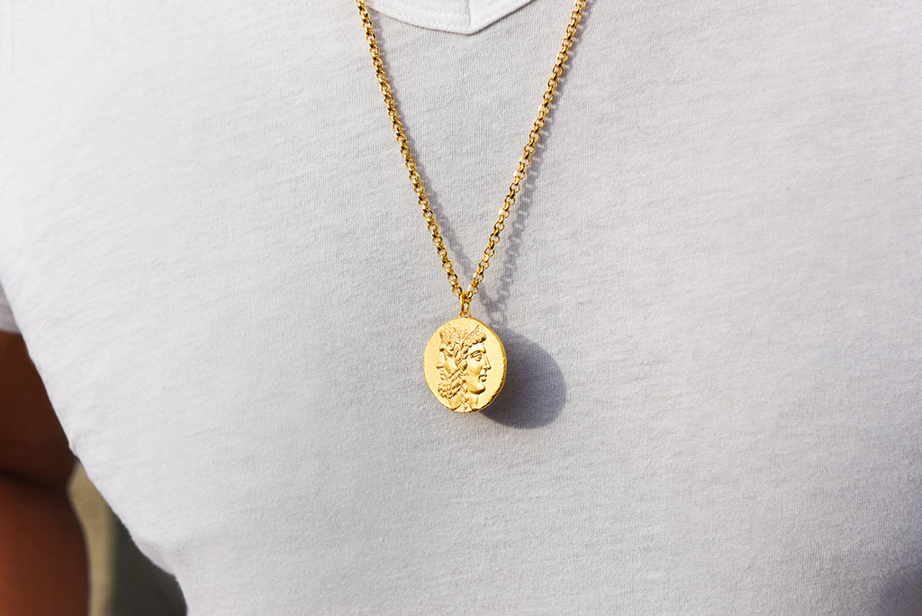 guy wearing roman coin pendant