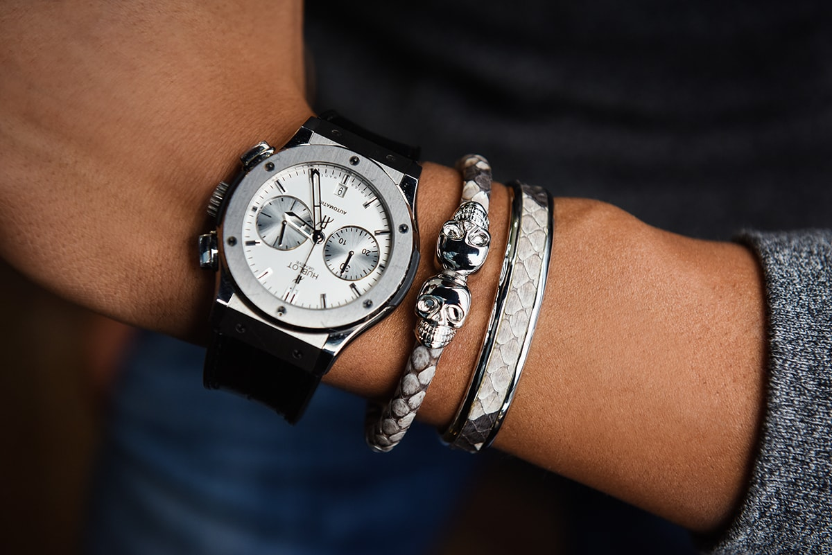 Man wearing silver luxury bracelet set with watch