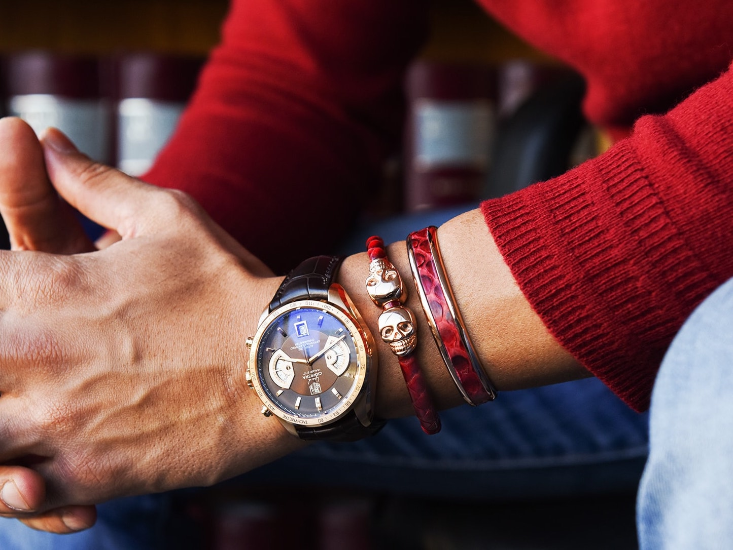 Skull Bracelet Collection Displayed on Wrist, while sitting