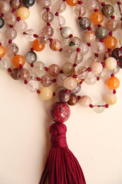 Rutilated quartz Mala Necklace with salmon coloured cotton tassel