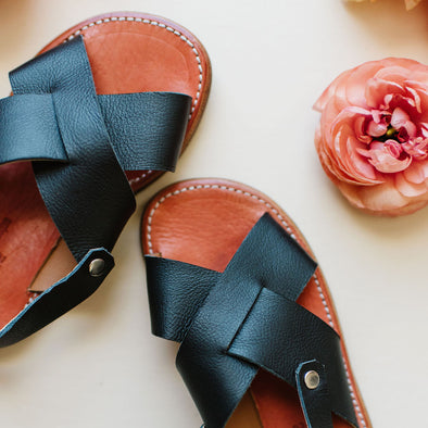 Adelisa & Co's handmade leather Cruz sandals for women. A simple criss cross style, handcrafted by artisans in Nicaragua.