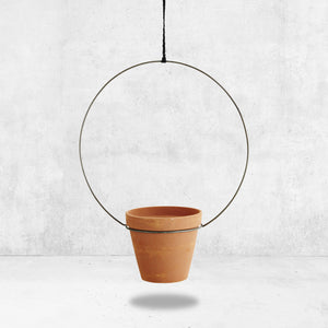 Hanging metal and terracotta planter