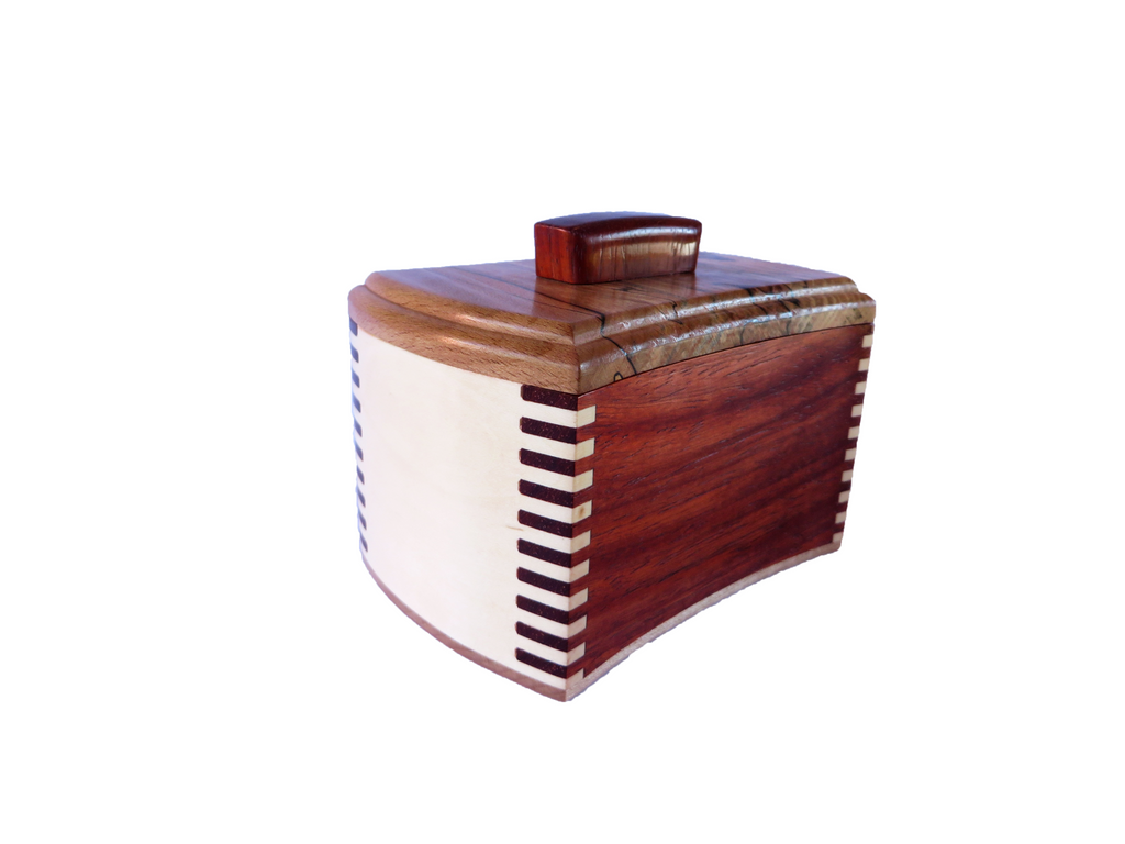 "One-of-a-kind handmade wooden box. Gently curving sides of American Holly and padauk interlock perfectly in 40 box joints. Spalted beech, with curly maple bottom. about 5"" W x 3 1/8"" W x 3 1/4"" H"