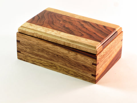 "One-of-a-kind handmade wooden box of delicate bird's eye maple in harmony with dramatic rainbow of cocobolo. Interior cushioned with elk hide. About 5"" x 3 1/8""x 2 1/8""H"