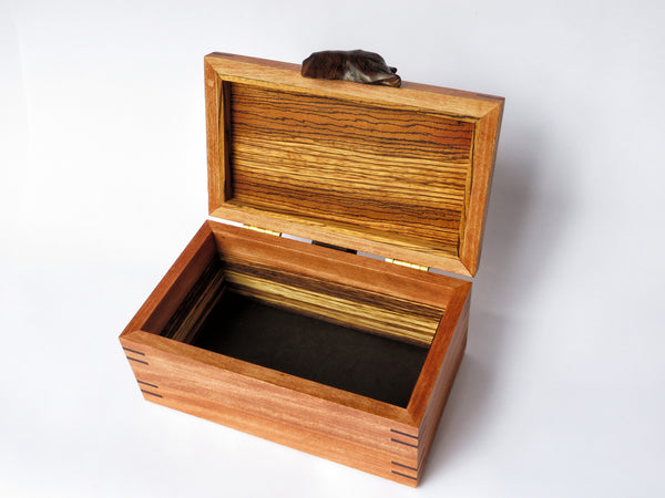 "One-of-a-kind handmade wooden box of hickory, zebrawood and padauk, with ironwood handle. Perfect gift for the holidays, graduation, or any other special occasion. About 10"" L x 5 7/8"" W x 5"" H"
