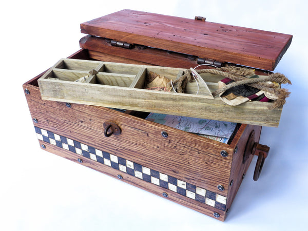 A one-of-a-kind handmade wooden box modeled after those pioneers took for the journey west. Handstained and distressed classic American woods, handpainted checkerboard, antiqued hardware.Removeable sliding tray for keepsakes of all sizes.