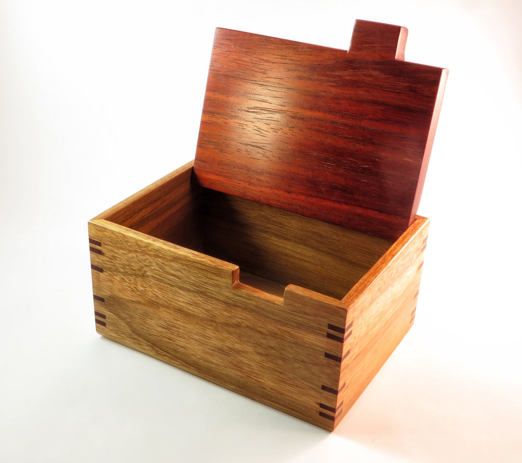 "One-of-a-kind handmade wooden box of canarywood, padauk, and ash. About 7"" L x 5"" W x 3 7/8"" H"