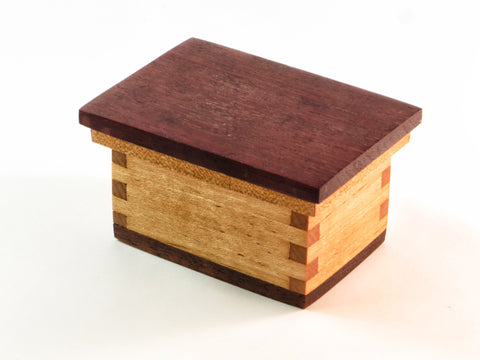 "Simple one-of-a-kind handmade wooden box for rings, ear buds and small wonders that hold your best memories. Cherry, padauk, walnut. About 3.5"" x 2.5 x 2"" H at lid."