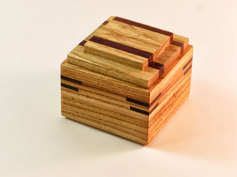 "Big design in small package. Use this one-of-a-kind handmade wooden box for cherished smalls or odds and ends. Ash, padauk, walnut. About 2 5/8"" sq x 2 1/4"" H"