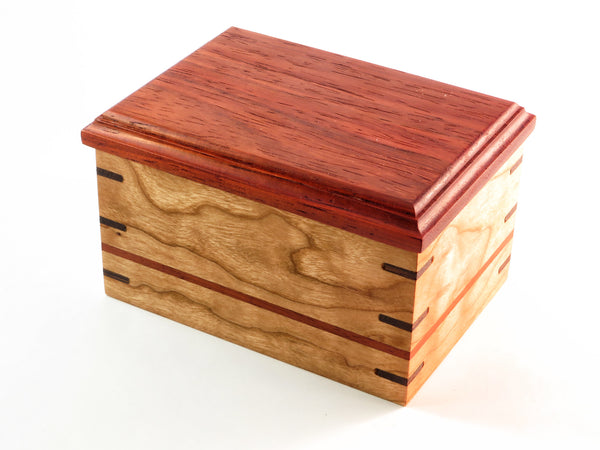 "One-of-a-kind handmade wooden box of sophisticated design. Figured cherry, padauk, wenge, ash. Solid cherry inset and contrasting splines. About 5 1/2"" x 4""x 3 1/4"""