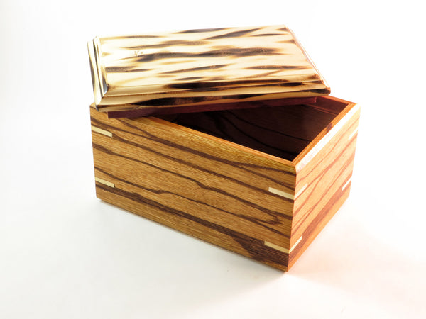 "One-of-a-kind handmade wooden box of American holly, flame-burned by hand. Marblewood base and inner lid of padauk. About 6 7/8"" L x 3 7/8"" W x 3 7/8"" H"