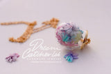 Necklace Pastel Colors Origami Flowers in Handblown Glass orb and Golden Brass