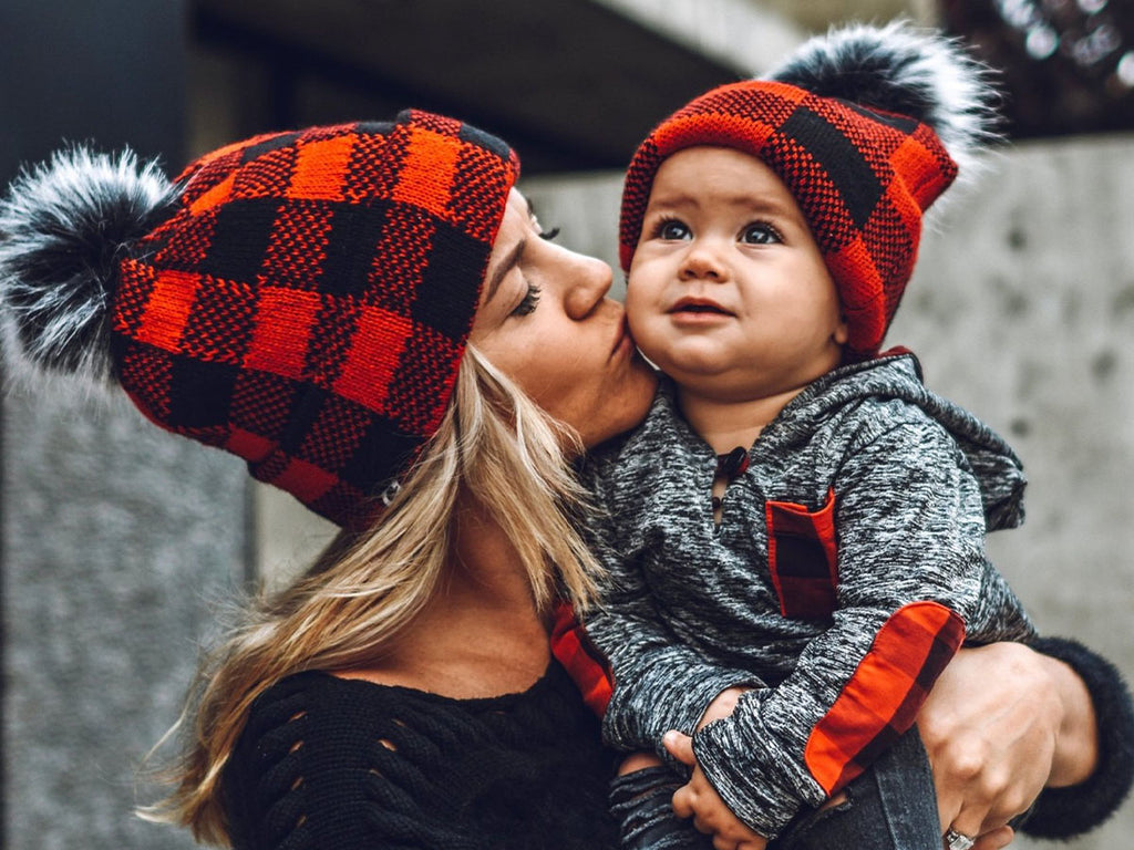 mom and baby with matching buffalo plaid print beanies