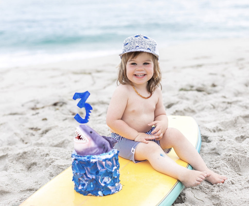 Image of Navy Stripe Swim Shorts from George Hats with shark cake.