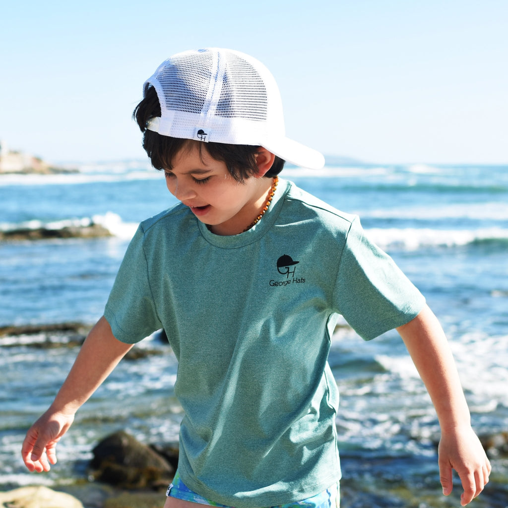 Image of child wearing a George Hats Sun Shirt.