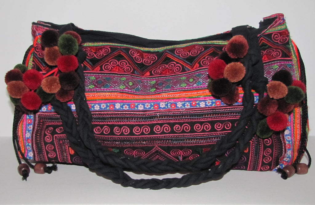 "Beautifully hand-crafted using traditional Hmong culture's colors and embroidery style. Spacious and perfect for weekend outings this purse will add character to any outfit! Measures 8"" high x 21"" wide; shoulder strap approx. 11"".  Zip closure with inside zip pocket."