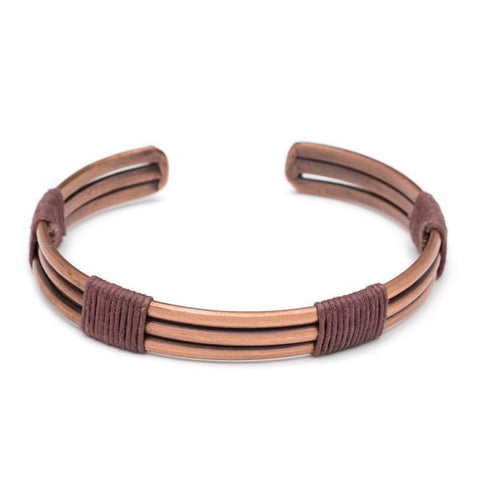 Men's brass cuff with three copper pieces bound together with waxed brown cotton string wrap accents. Hand-made in India.