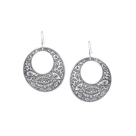 "Silver colored brass earrings hand-etched with an intricate floral motif.  These are statement makers and the perfect accent to your LBD or a simple classic sweater. Measure 2"" w x 2"" h."
