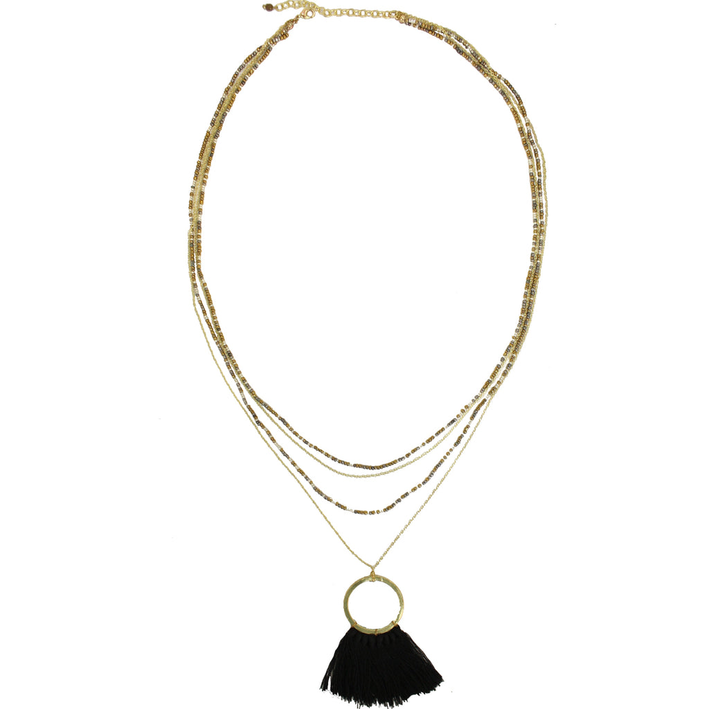 "Sleek and chic statement maker! Black tassel hangs 2"" below a gold tone circle pendant with two mixed metal beaded chains to polish off this stylish look. Measures 27 1/2"". Hand-made in India. World Finds."