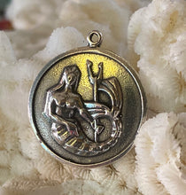 Tiny mermaid carrying bi-dent.  Sterling silver copy of vintage/antique charm.