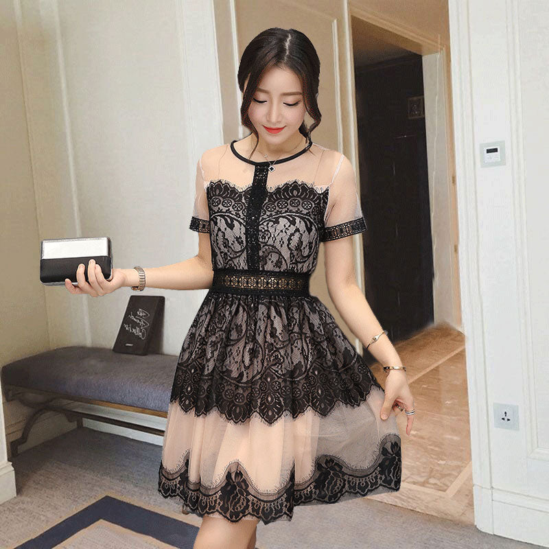 The new Korean version of the summer and Summer Edition is a long and medium style hook and flower hollowed silk dress, female tennis gauze, A skirt.
