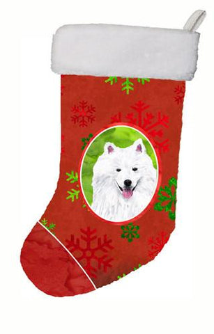 Buy this American Eskimo Red and Green Snowflakes Holiday  Christmas Stocking