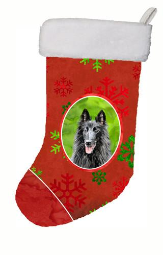 Belgian Sheepdog Red and Green Snowflakes Holiday  Christmas Stocking SC9438 by Caroline's Treasures