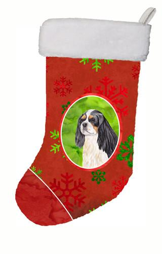 Cavalier Spaniel Red and Green Snowflakes Holiday  Christmas Stocking SC9431 by Caroline's Treasures