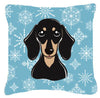 Snowflake Smooth Black and Tan Dachshund Fabric Decorative Pillow BB1649PW1414 by Caroline's Treasures