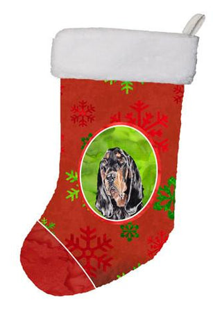Buy this Black and Tan Coonhound Red Snowflakes Holiday Christmas Stocking SC9581-CS