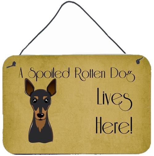 Min Pin Spoiled Dog Lives Here Wall or Door Hanging Prints BB1488DS812 by Caroline's Treasures