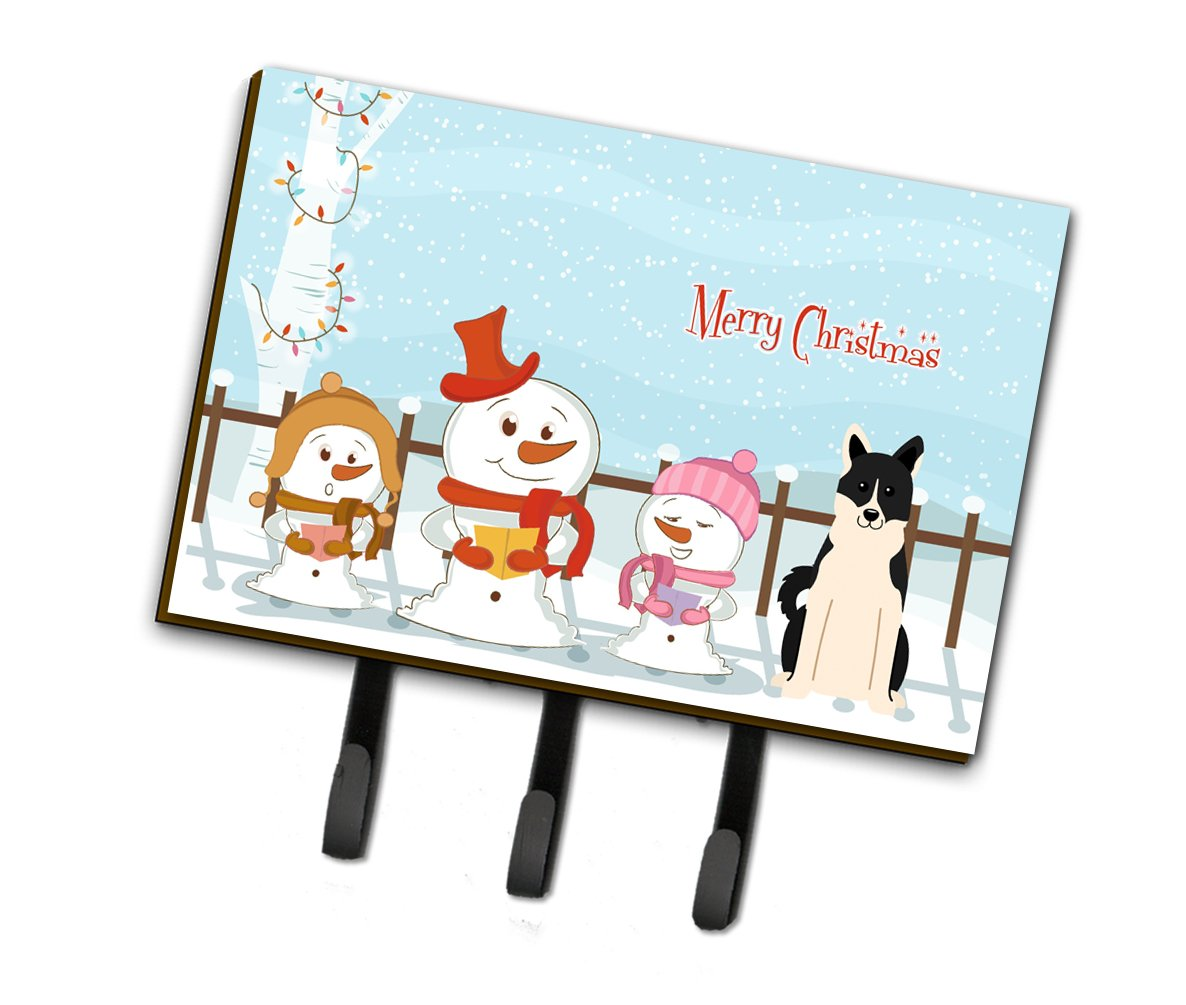 Merry Christmas Carolers Russo-European Laika Spitz Leash or Key Holder by Caroline's Treasures