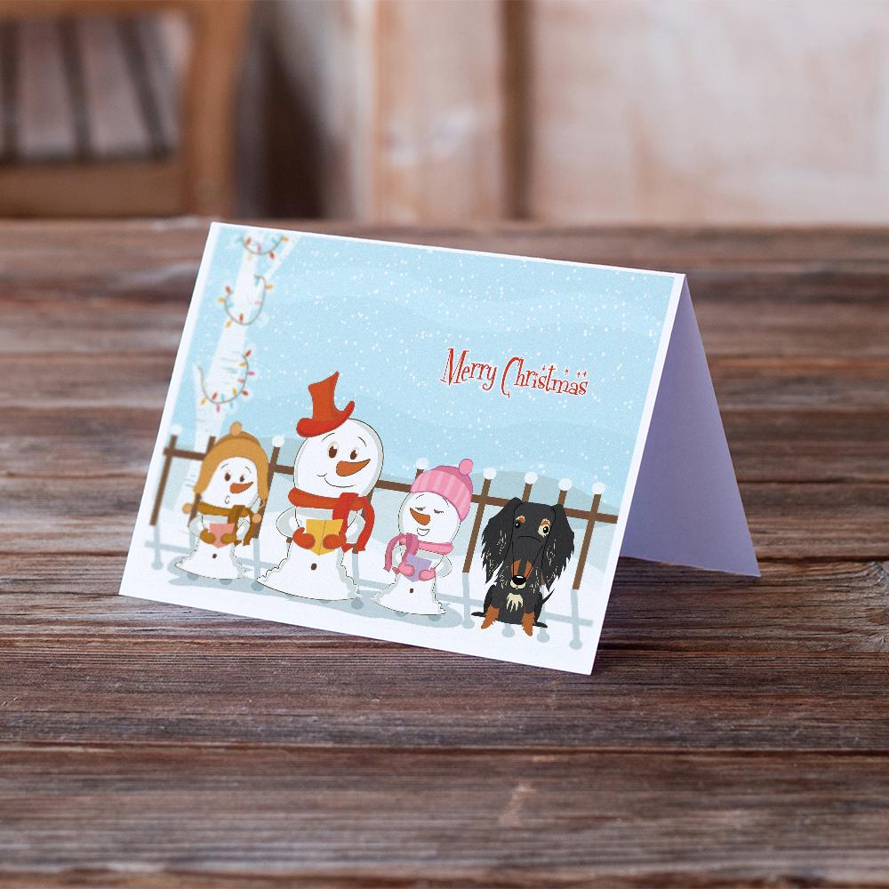 Buy this Merry Christmas Carolers Wire Haired Dachshund Dapple Greeting Cards and Envelopes Pack of 8