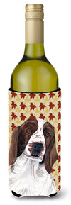 Welsh Springer Spaniel Fall Leaves Portrait Wine Bottle Beverage Insulator Beverage Insulator Hugger by Caroline's Treasures