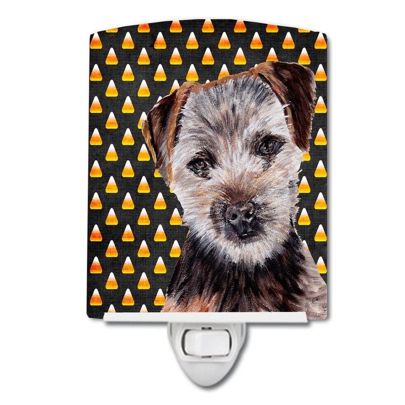 Buy this Norfolk Terrier Puppy Candy Corn Halloween Ceramic Night Light SC9663CNL