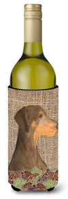 Doberman on Faux Burlap with Pine Cones Wine Bottle Beverage Insulator Beverage Insulator Hugger by Caroline's Treasures