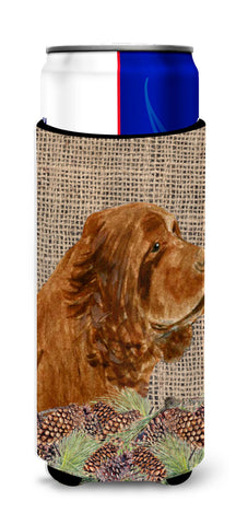 Buy this Sussex Spaniel on Faux Burlap with Pine Cones Ultra Beverage Insulators for slim cans SS4099MUK